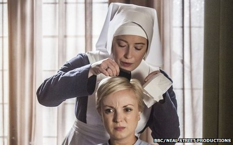 Nun checking Trixie the midwife for headlice