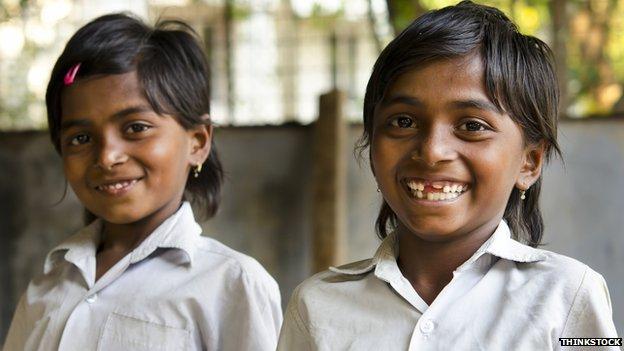 Two smiling Indian schoolgirls