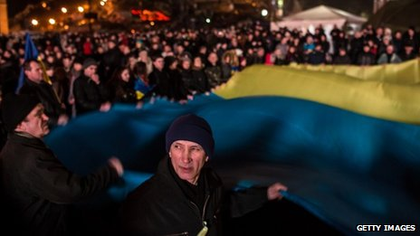People wave a large Ukrainian flag in Independence Square on February 23, 2014 in Kiev, Ukraine