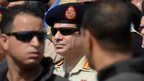 "A file picture taken on September 20, 2013 shows Egypt""s army chief Abdel Fattah al-Sisi (C) attending a military funeral in the district of Giza, on the outskirts of Cairo."