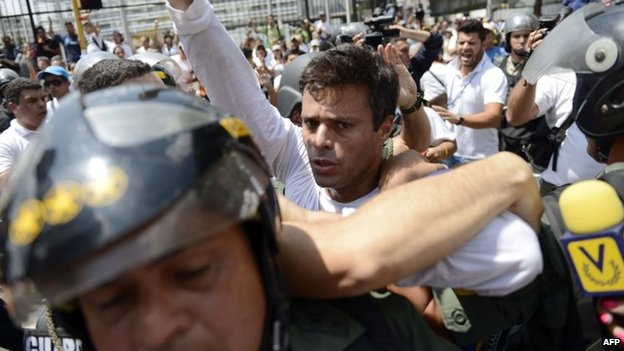 Leopoldo Lopez is escorted by the national guard after he turned himself in, during a demonstration in Caracas, on 18 February, 2014