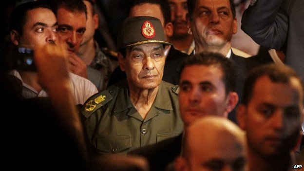 Egyptian Field Marshal Mohammed Hussein Tantawi (C) arrives at the funeral of former Vice-President Omar Suleiman in Cairo on 21 July 2012