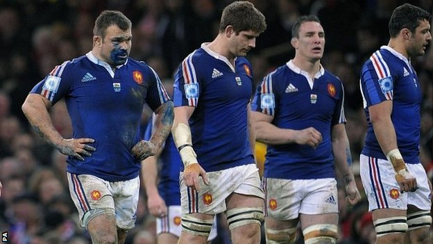 France players look dejected during their defeat by Wales in Cardiff