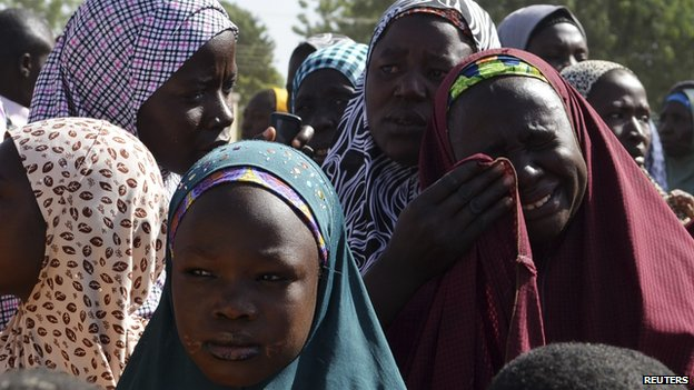 A woman from Gwoza, Borno State, displaced by the violence and unrest caused by the insurgency, weeps at a refugee camp in Mararaba Madagali, Adamawa State, on 18 February 2014.