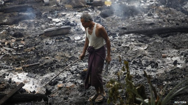 File photo: A Muslim man searches for his belongings left behind of his burnt home at Thapyuchai village, outside of Thandwe in the Rakhine state, following deadly Muslim-Buddhist clashes, 2 October 2013