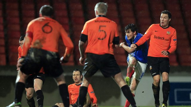 Linfield's Philip Lowry scores the equaliser against Glenavon