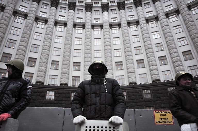 Anti-Yanukovych protesters guard a government building in Kiev
