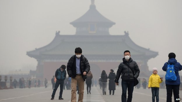 This picture taken on 24 February 2014 shows visitors wearing masks in Temple of Heaven in haze-covered Beijing