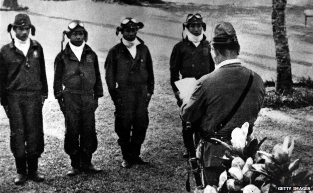 Four kamikaze pilots receiving orders
