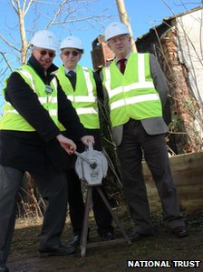 Bob Shaw (left) signalling the start of the restoration work by sounding an air raid siren with Ian Barber, from Severn Waste, and Dennis Williams of the heritage group outside the building
