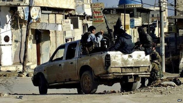 Islamic State in Iraq and the Levant (ISIS) militants patrol the Syrian city of Raqqa (14 January 2014)