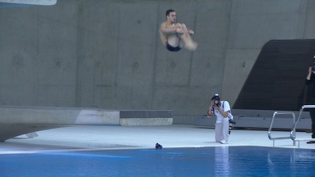 Tom Daley practices a dive