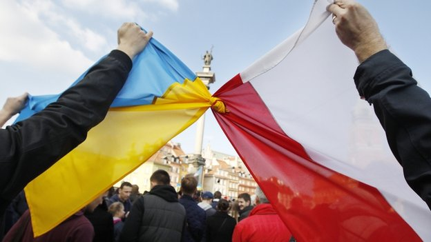 Polish and Ukraine flags tied together in Warsaw rally. 23 Feb 2014