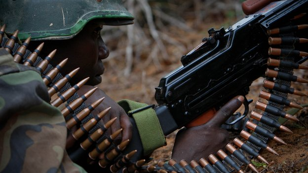 An African Union soldier takes cover during a battle in Somalia on 22 May 2012