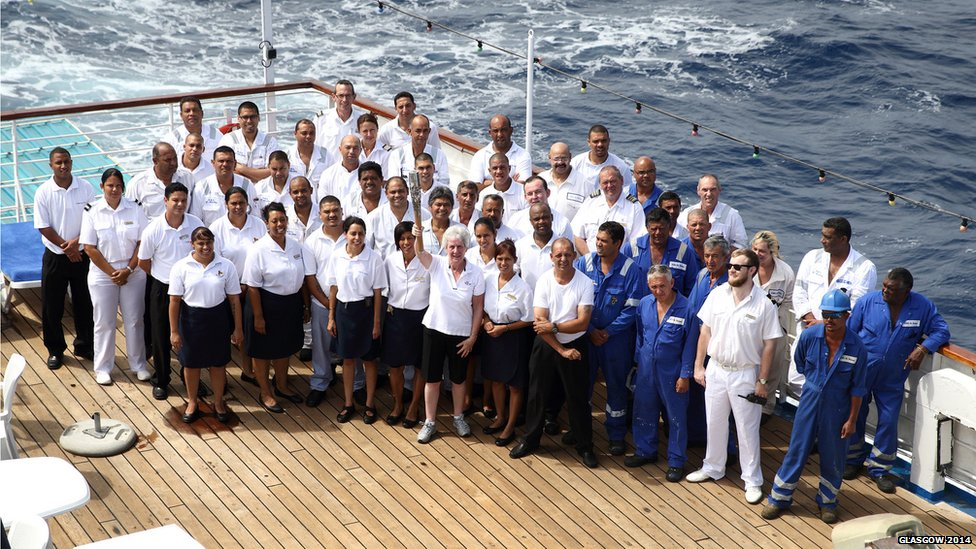 Commonwealth Games Federation Honorary Secretary General Louise Martin CBE holds the Queen's Baton with the RMS St. Helena