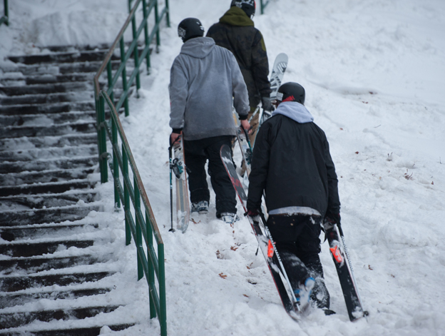 Khai Krepela, Logan Imlach and Snady Boville walking next to a rail in St Paul, Minnesota