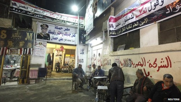 Posters of Army chief Abdel Fattah al-Sisi adorn the walls of an area of Cairo's Gamaliya district, where he spent his childhood January 21, 2014.