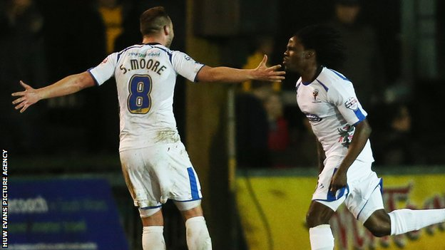 AFC Wimbledon's Kevin Sainte-Luce celebrates after scoring his side's winner against Newport