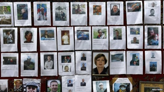Photos of some of those killed in recent violence are seen at a makeshift memorial in Kiev's Independence Square
