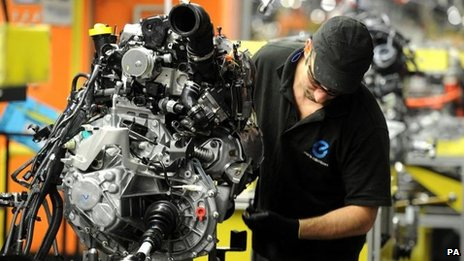 A Nissan employee works on the second generation Qashqai, at the Nissan plant in Sunderland