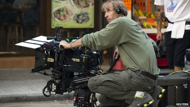 "US director and producer Michael Bay holds a camera during the filming of a scene for the movie ""Transformers: Age of Extinction"" in Hong Kong, 24 October 2013"