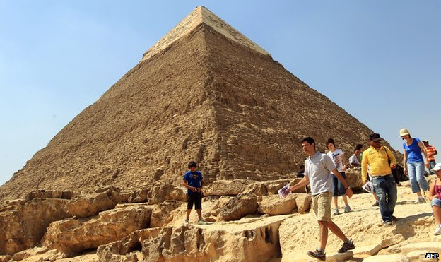 A tourist walks in front the Great Pyramid of Khafre in Giza, on 30 March 2010