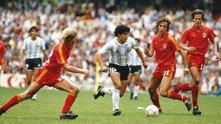 Diego Maradona scores against Belgium