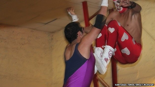 Men wrestling in costume