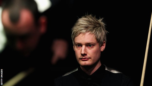 Neil Robertson watches Mark Williams at the table
