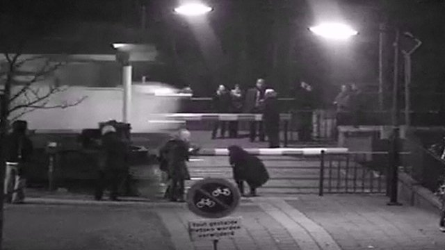 CCTV of train and pedestrians