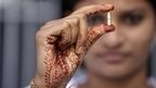 Schoolgirl in India shows bullet claimed to have been fired across border