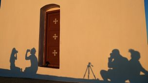 Shadows on a church wall