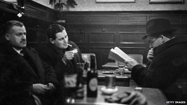 Irish novelist Flann O'Brien (right) with friends in the Palace Bar in Dublin