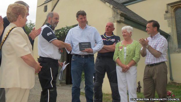 The people of Colwinston receive their 'thankful' village plaque