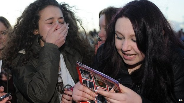 Morgan Evans (left), aged 14, from Sheffield and Chloe Harrison, aged 14, from Hull react after meeting Louis Tomlinson after he arrived at the Keepmoat Stadium, Doncaster where he is making his debut for the reserves.