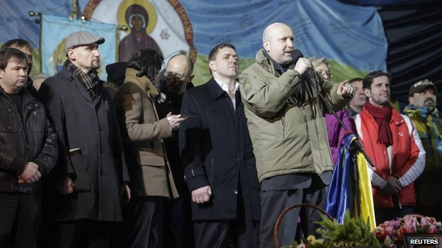 Acting President Oleksander Turchinov speaks on the stage, with candidates for ministerial positions seen in the background, during a rally in Independence Square in Kiev on 26 February 2014.