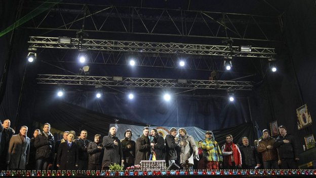 Candidates for ministerial positions stand on the stage during a rally in Independence Square in Kiev, on 26 February 2014.