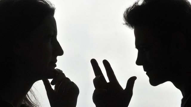 man and woman silhouette arguing