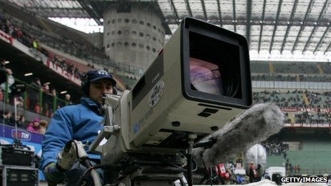 An Italian television cameraman in the San Siro stadium before an AC Milan match