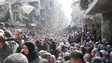 A vast crowd of people queue for aid at the Yarmouk refugee camp near Damascus on 31 January