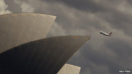 Qantas plane flies past Sydney Opera House