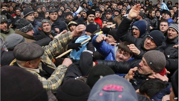 Pro-Russian protesters, right, clash with Crimean Tatars in front of a local government building in Simferopol, Crimea