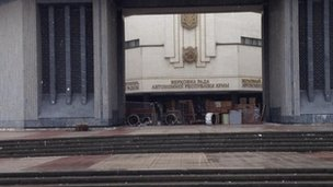 Image by Kevin Bishop of barricaded entrance to Crimean parliament