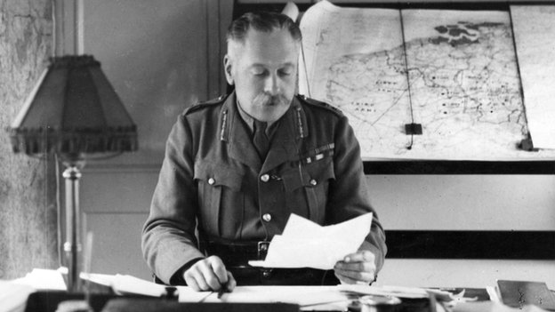 Field Marshal Sir Douglas Haig (1861-1928) in his headquarter train in France during the First World War, with maps of France and Belgium behind him.