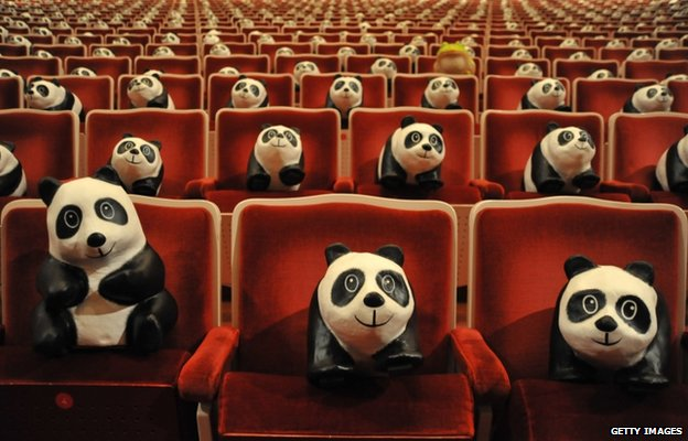A paper rhacophorus arvalis (farmland green tree frog) is surrounded by paper pandas at the National Theatre in Taipei, Taiwan
