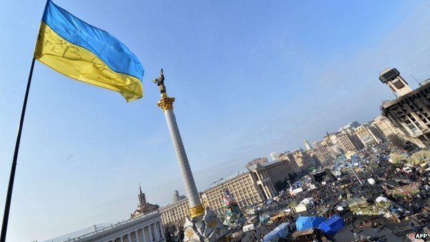 A Ukrainian flag flutters over Independence Square in Kiev