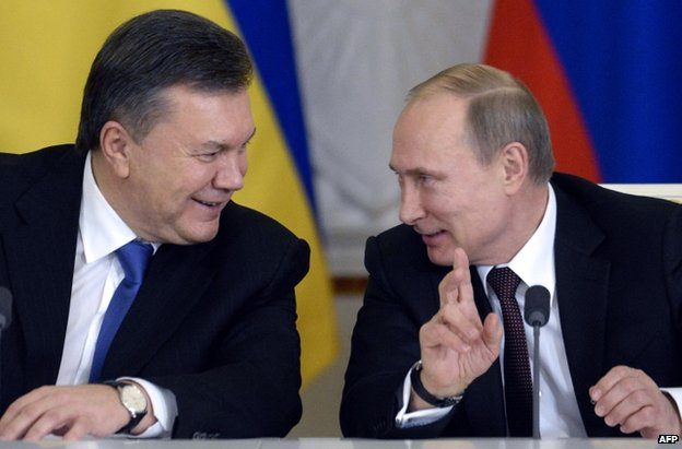 Ukrainian President Viktor Yanukovych (left) with his Russian counterpart, Vladimir Putin, in Moscow, 17 December