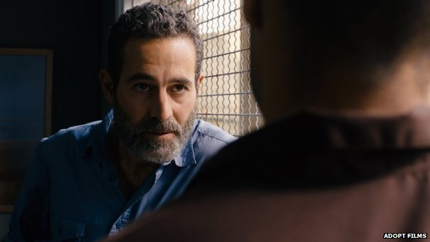 The character, Omar (Adam Bakri) speaks to an Israeli intelligence agent played by Waleed Zuaiter