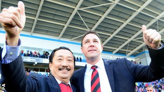 Vincent Tan and Malky Mackay celebrate