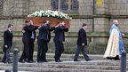 Pallbearers arrive at Preston Minster